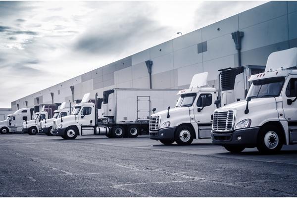 logistics trucks at a warehouse