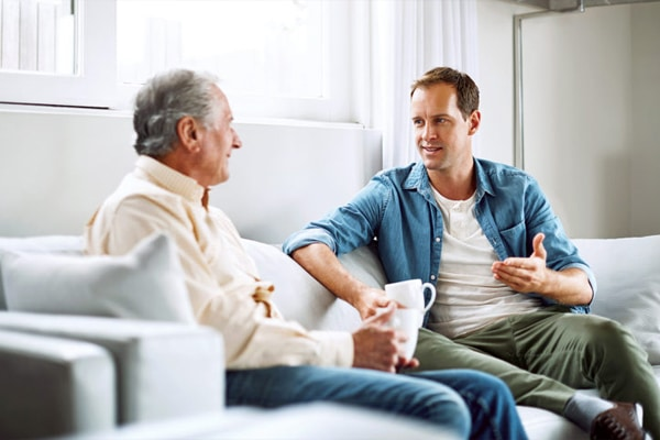 a man talking to his elderly father