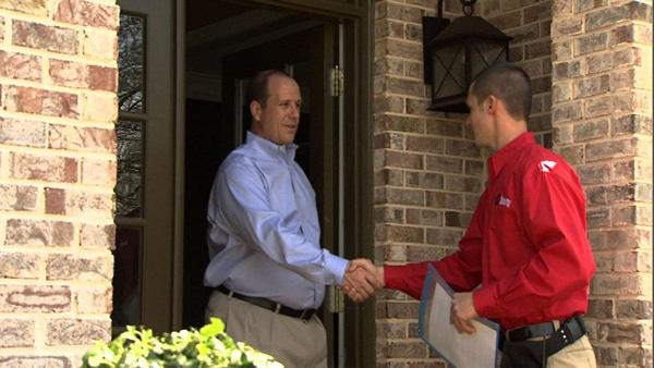 an EMC contractor greets a customer