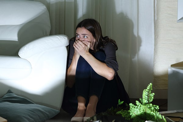a woman hides from burglars