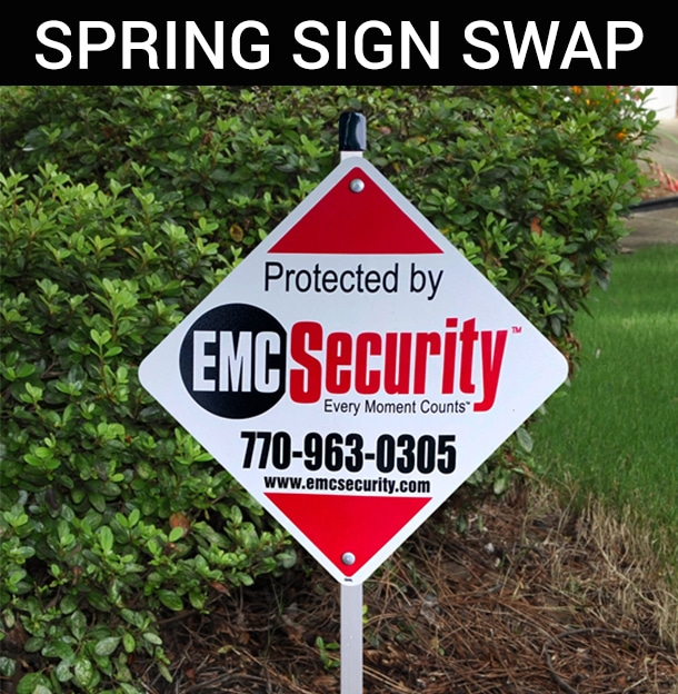an EMC security sign in front of a house
